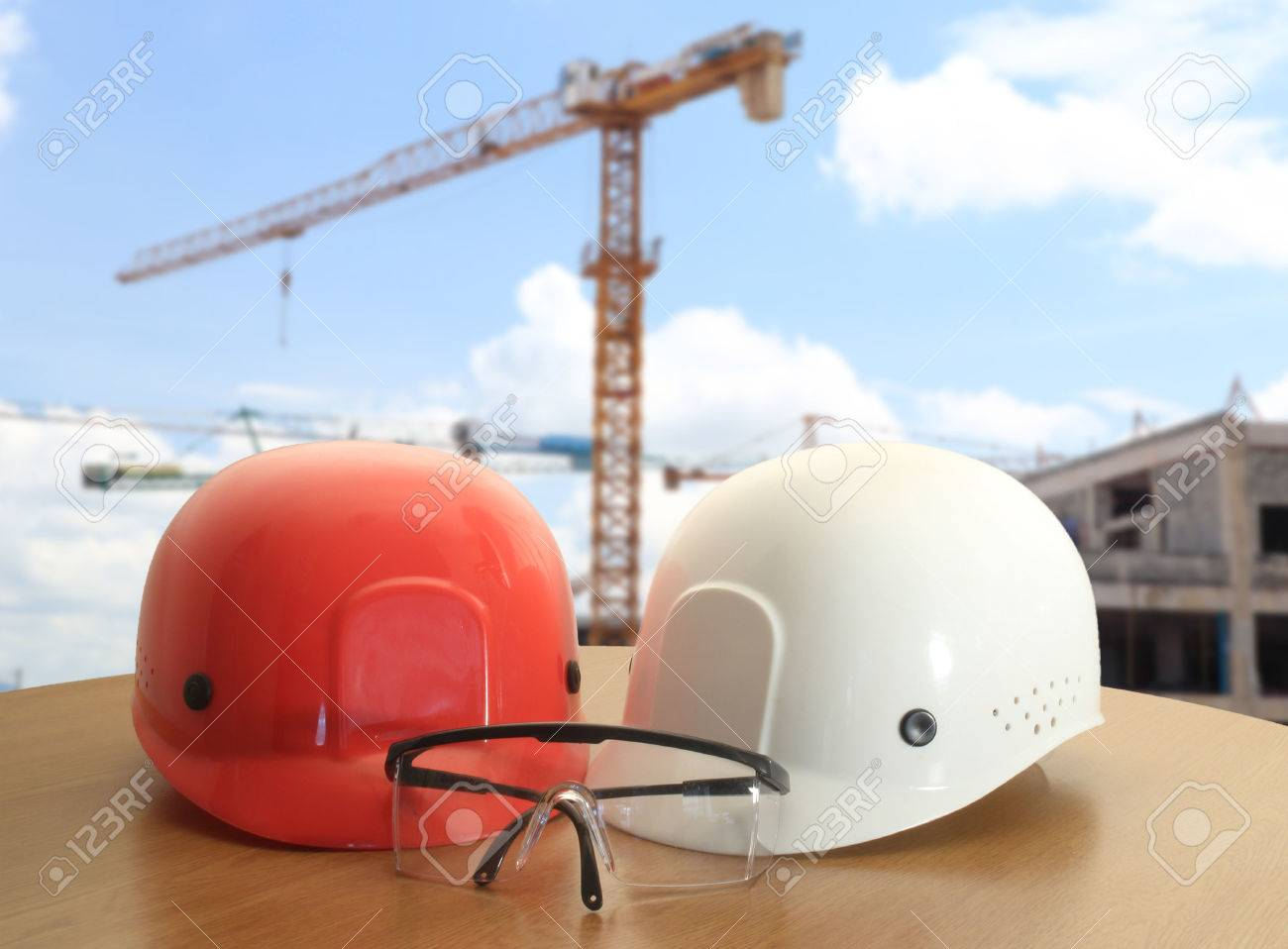 safety helmet on civil engineer working table and work area background - 41334265