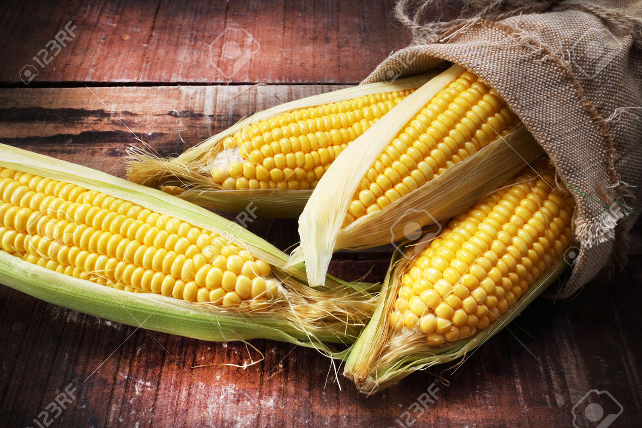 fresh corn on wooden table - 41459856