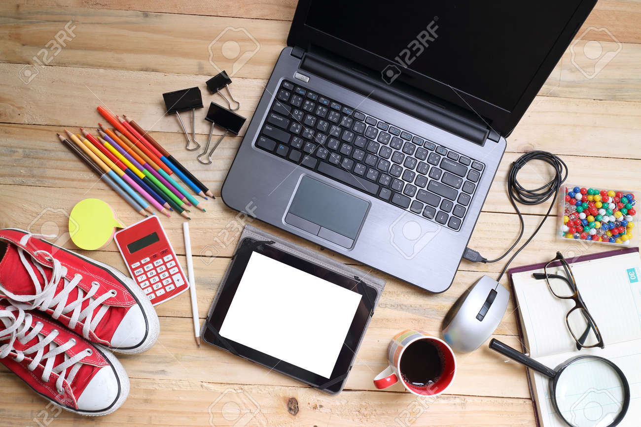 overhead of office table or student table with notebook, computer keyboard and mouse, tablet pc and smartphone. copy space - 42541131