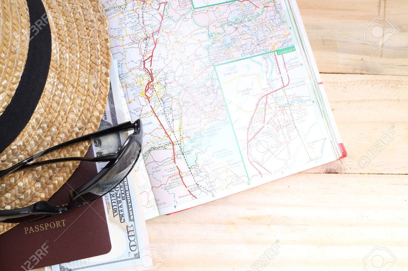 travel concept, Preparation for travel, money, passport, road map on wooden table - 43149741