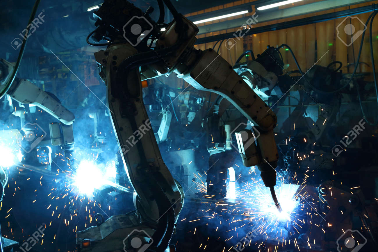 group welding robots are working In the automotive parts industry. - 44116491