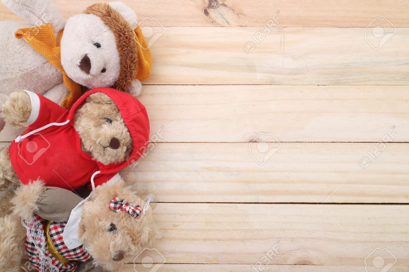 three cute teddy bear on wood background stock photo picture and