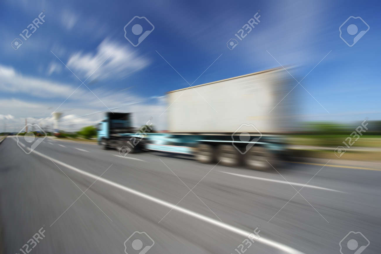 Generic big trucks speeding on the highway at sunset - Transport industry concept , big truck containers - 45173026