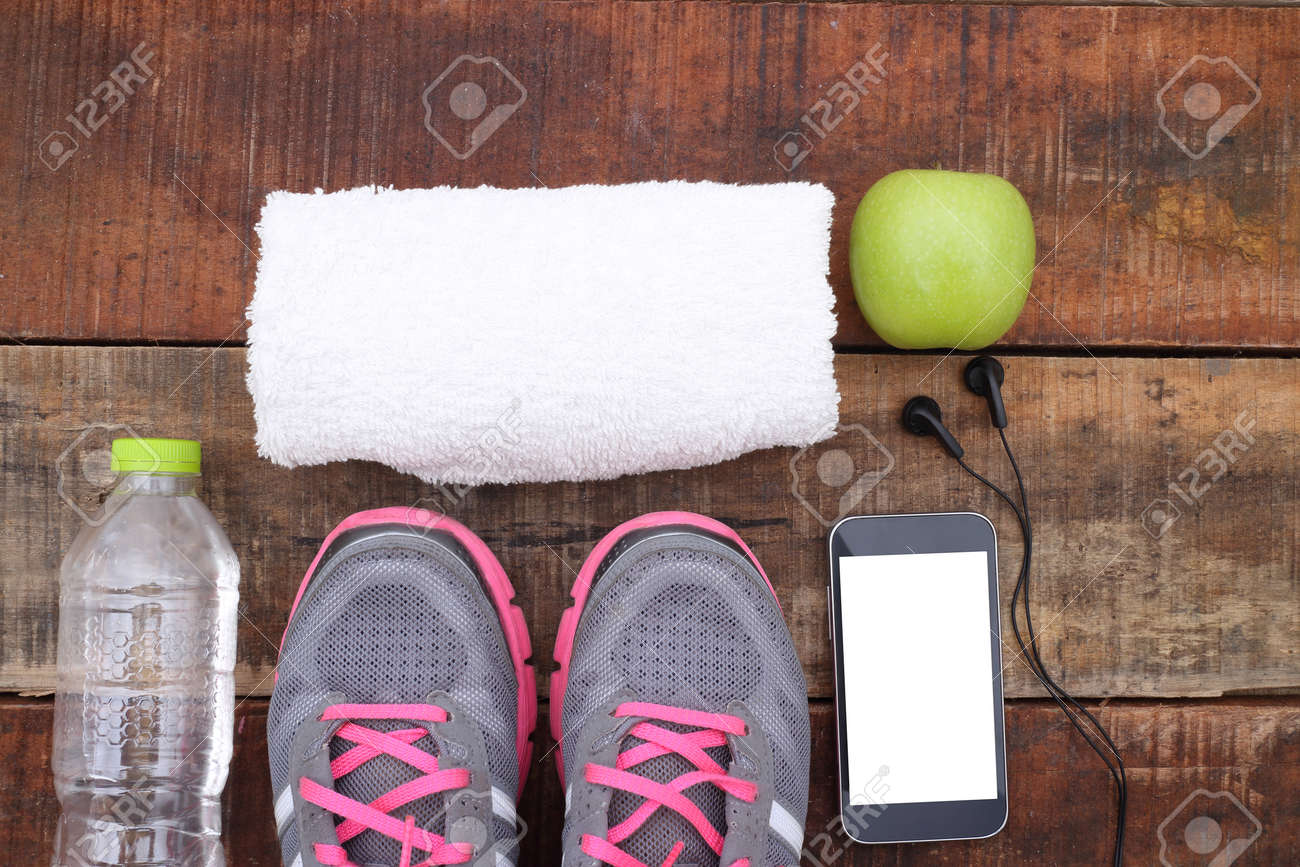 Sport shoes and water with set for sports activities on tiled floor. - 46019956