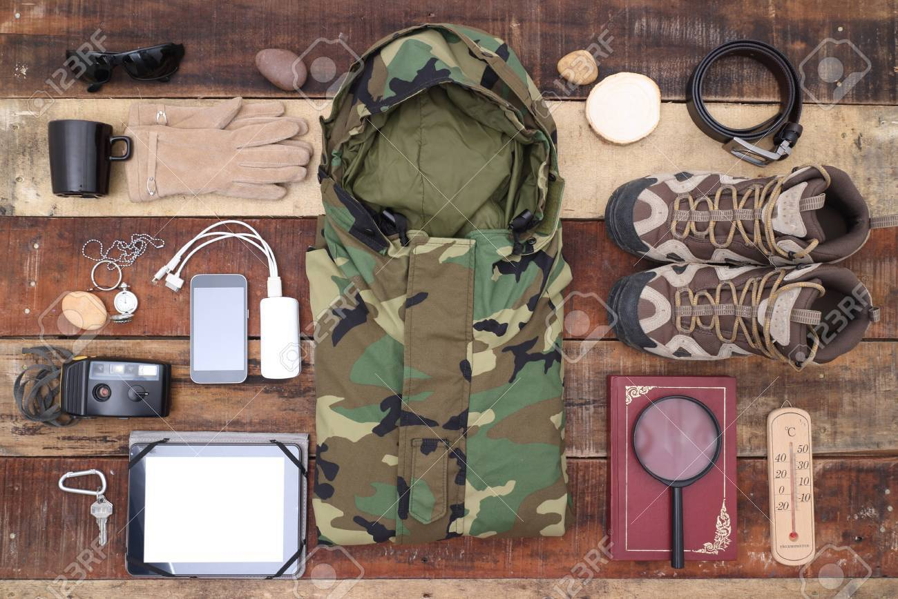 travel outdoor camping equipment set on wood background - 47866531