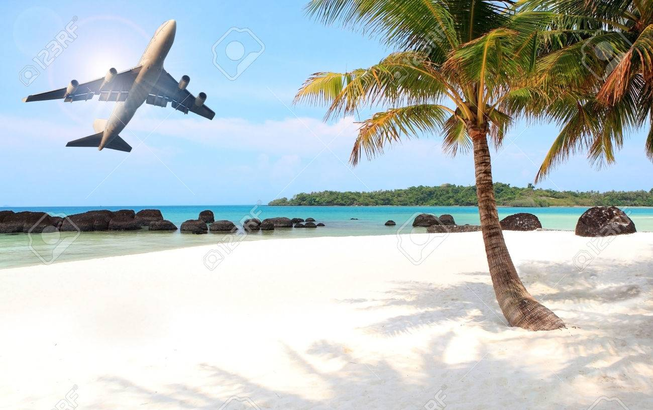 passenger plane flying over beautiful blue ocean and island in purity destination sea beach use for summer holiday vacation traveling - 47866538