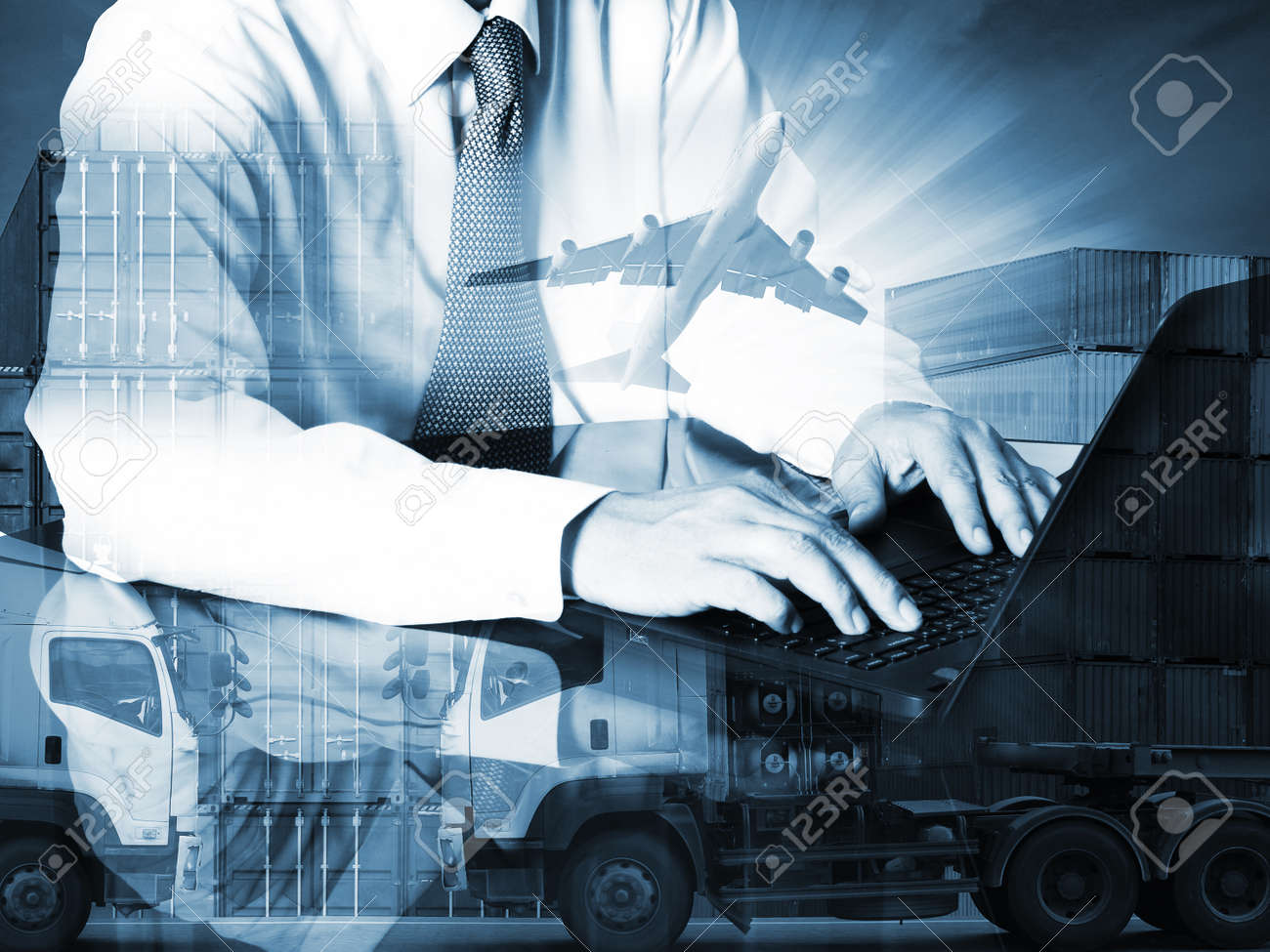 Double exposure of success businessman using computer with container truck ,ship in port and freight cargo plane in transport and import-export commercial logistic ,shipping business industry - 48795748