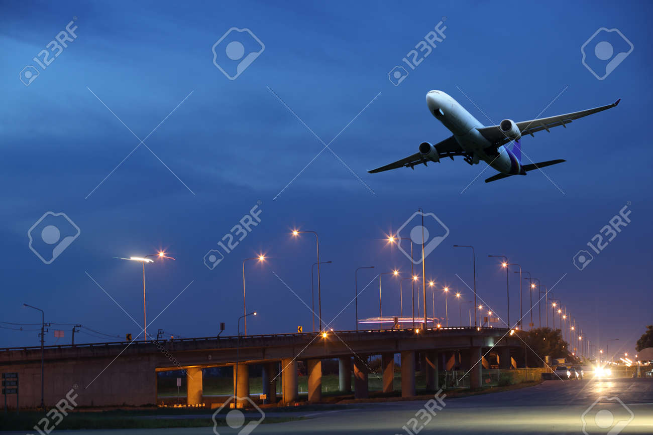 White aircraft departs from the airport Runaway in the night - 68361076