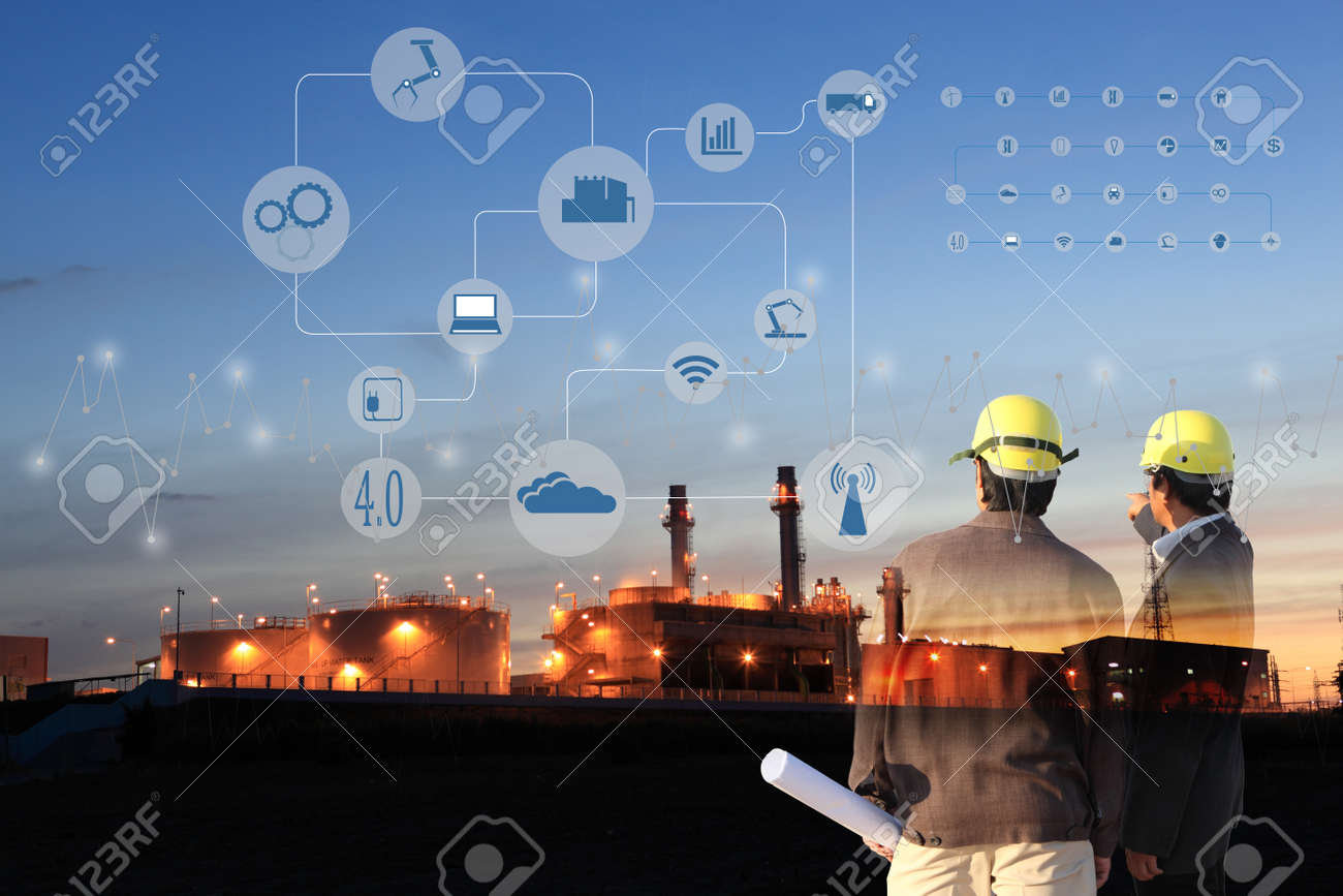 two engineer on site , Industry 4.0 concept image.Oil refinery at twilight with cyber and physical system icons diagram on industrial factory and infrastructure background. - 68949158