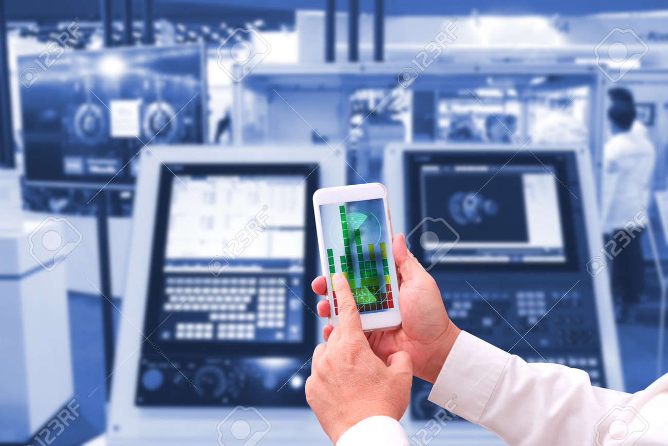industry 4.0 , concept of Man hand holding tablet with Augmented reality screen software and blue tone of automate wireless Robot arm in smart factory background. mixed media - 81015207