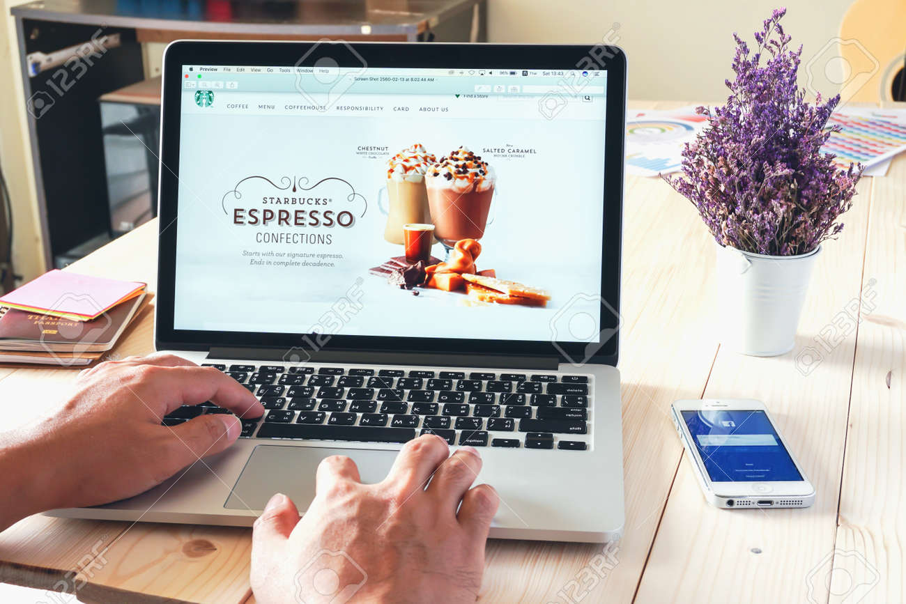 apple thailand office. BANGKOK ,THAILAND - March 05, 2017 : Apple Macbook Opening Online Page Of Starbucks Thailand Office
