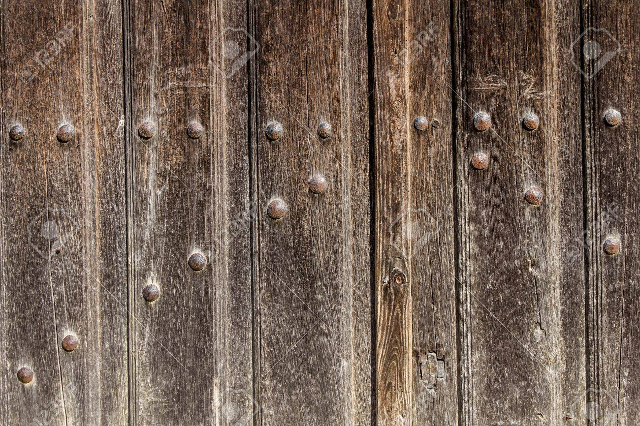 Old Wooden Gate With Iron Nails For Background Or Texture Stock Photo