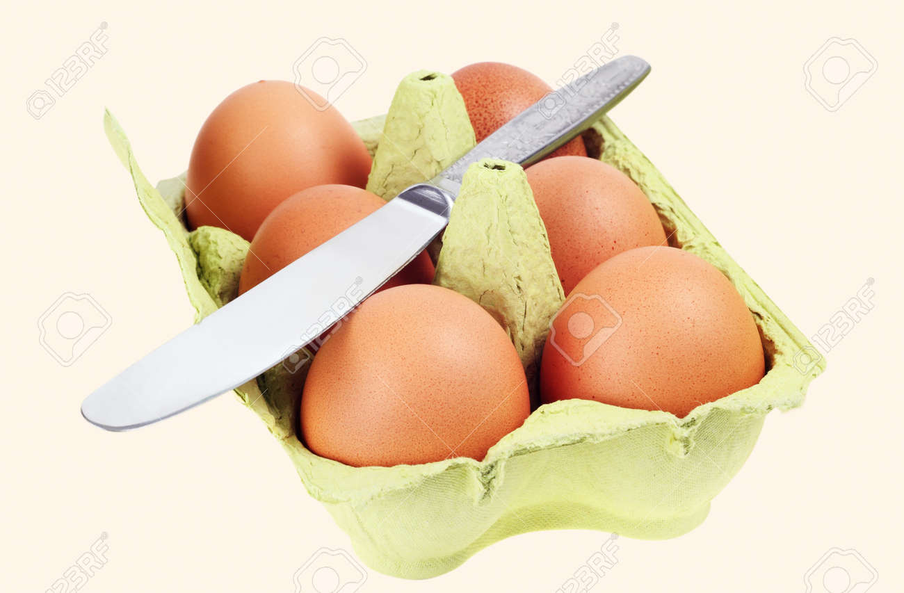 Brown eggs  The green cardboard box  Metal kitchen knife Stock Photo - 13234743