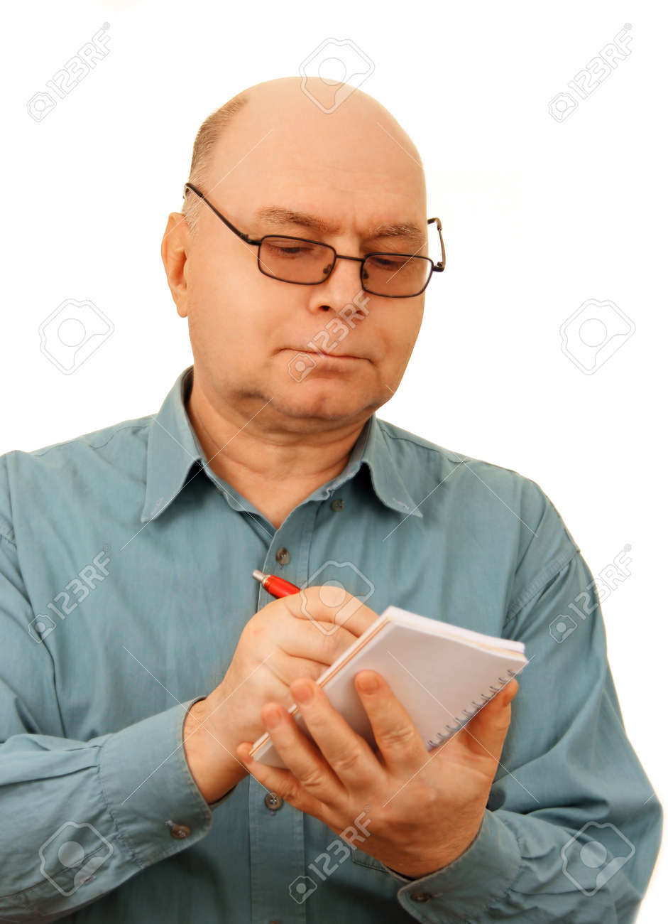 a middle-aged man in a blue shirt with a notebook and pen in hand, isolated on white background Stock Photo - 18410861