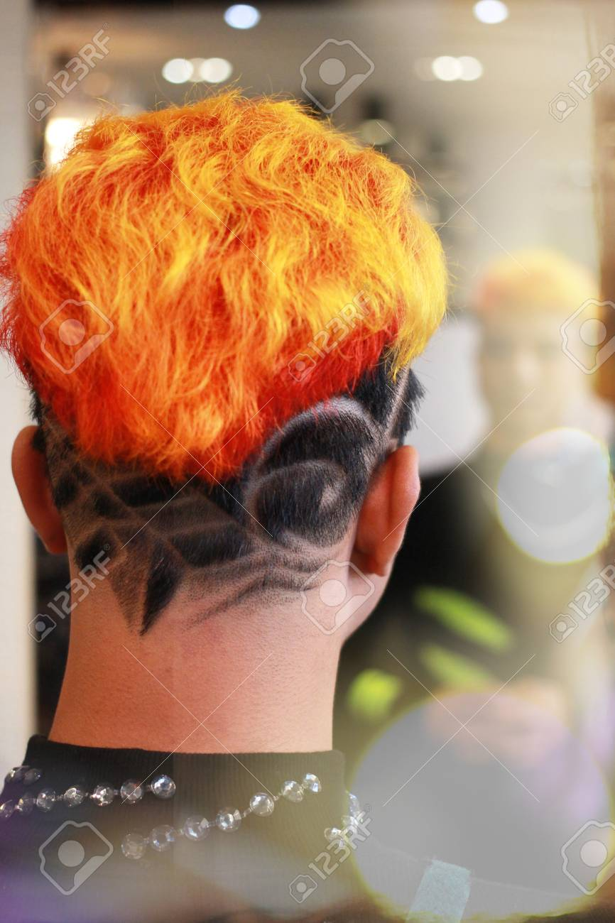Finish Dyed Hair In Orange And Graphic Shaved