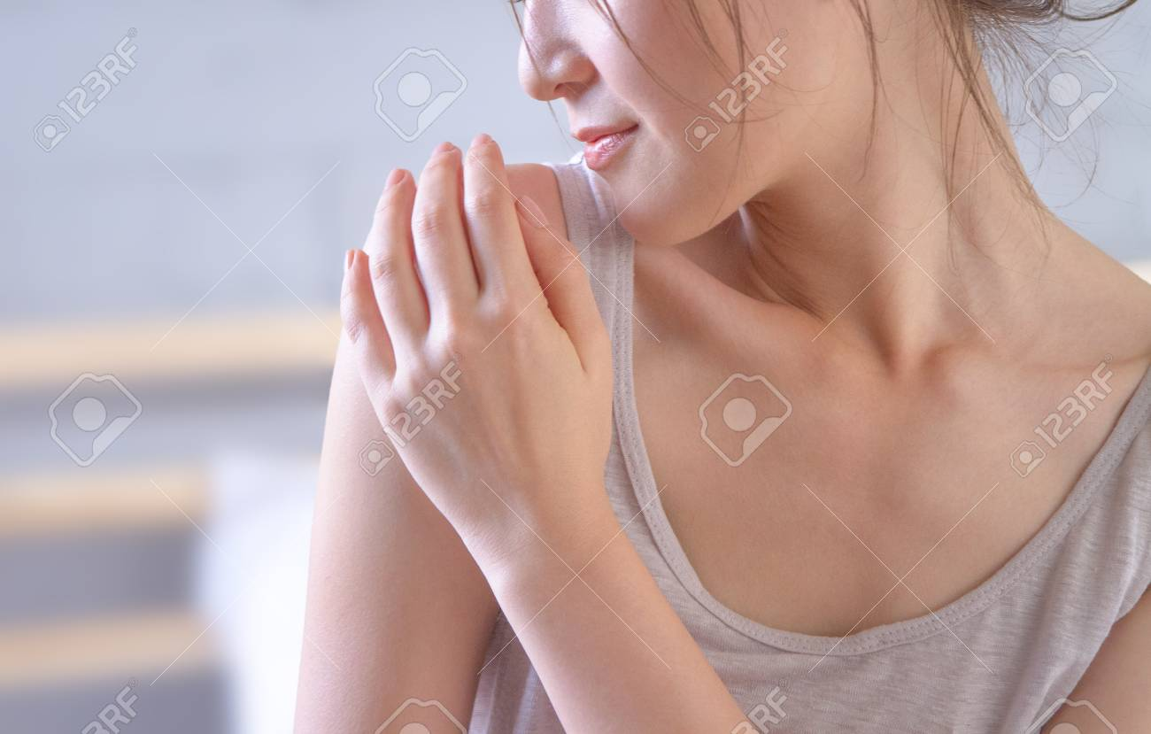 young woman touching her shoulder prouding with her healthy skin after applying the cream - 110520377