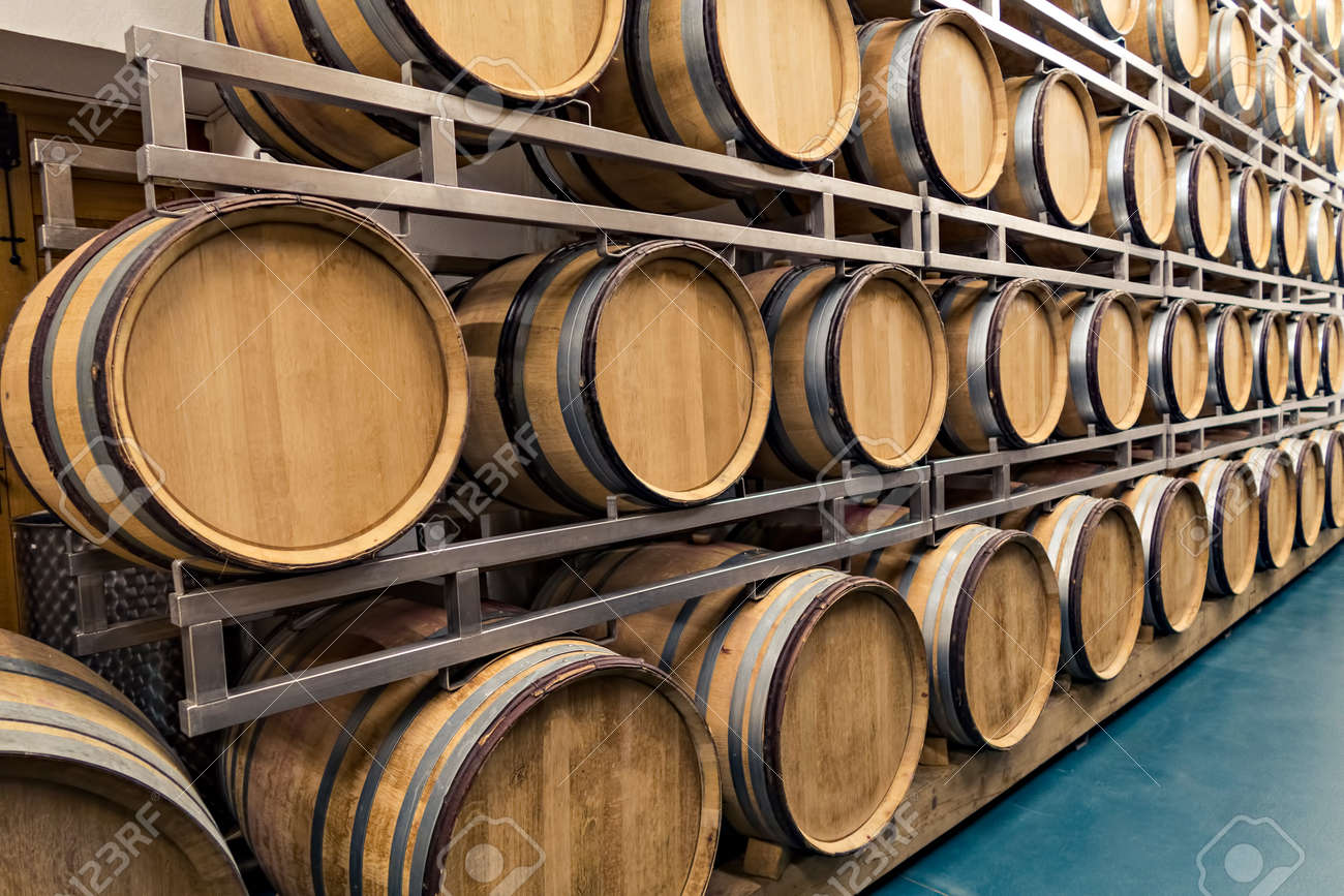 Traditional Old Wooden Barrels Are Used In Top Wine Cellars Stock