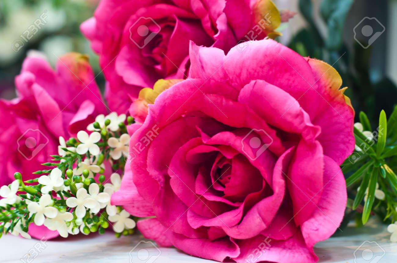 Fuchsia colored artificial roses Stock Photo - 13894378