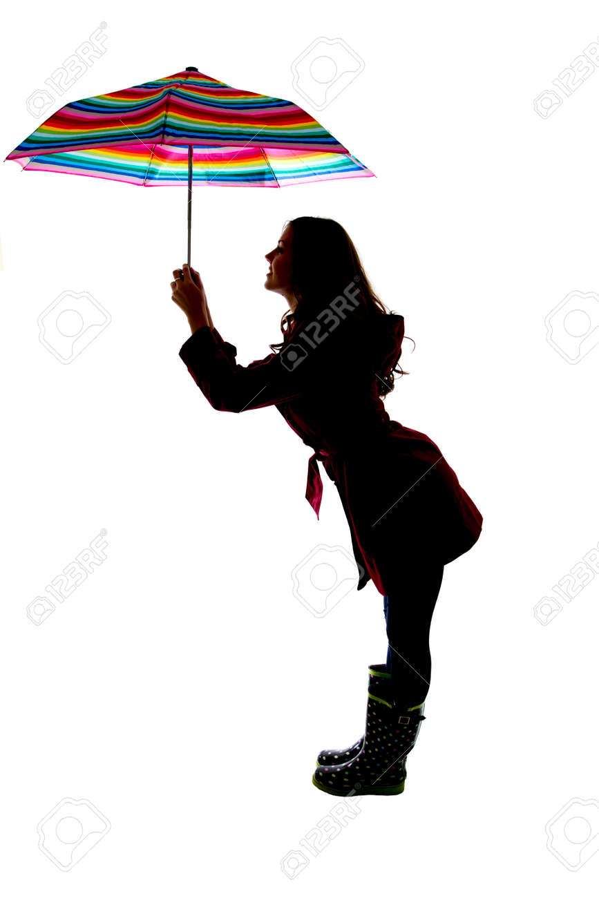 Cute Pose Silhouette Woman Holding Colorful Umbrella Stock Photo