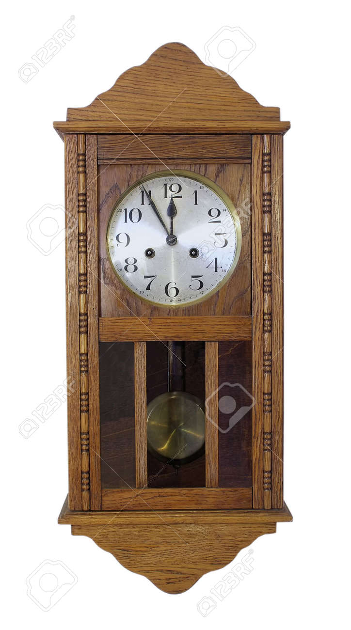 vintage wall clock with pendulum in wooden body stock photo