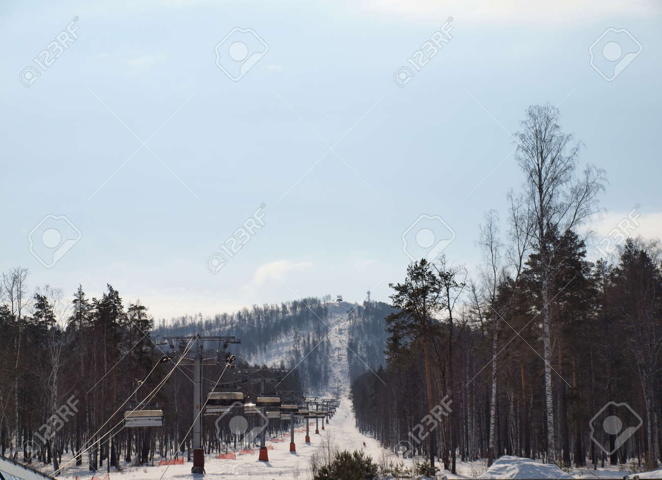 Views of the ski lift on a slope covered with forest Stock Photo - 9181997