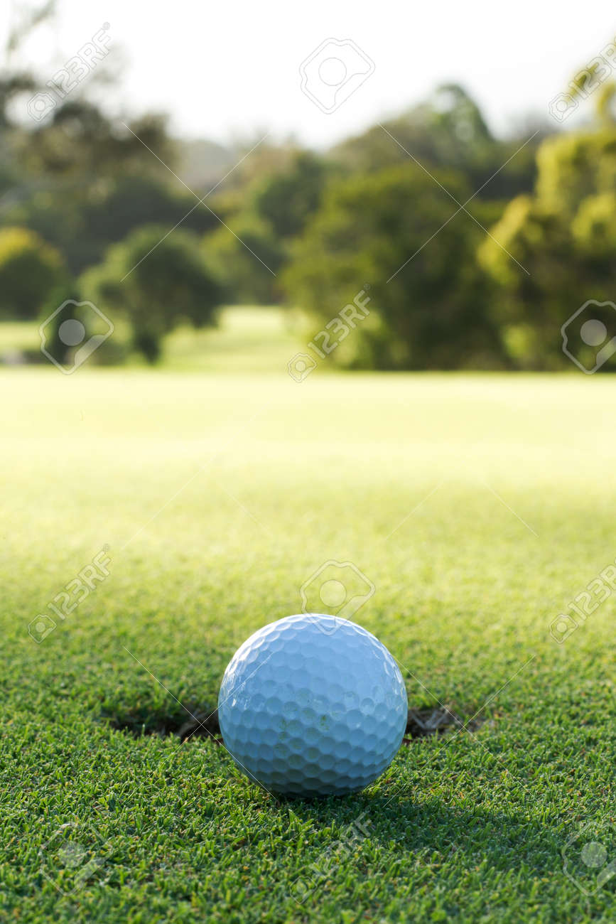 A golf ball and hole Stock Photo - 10314510