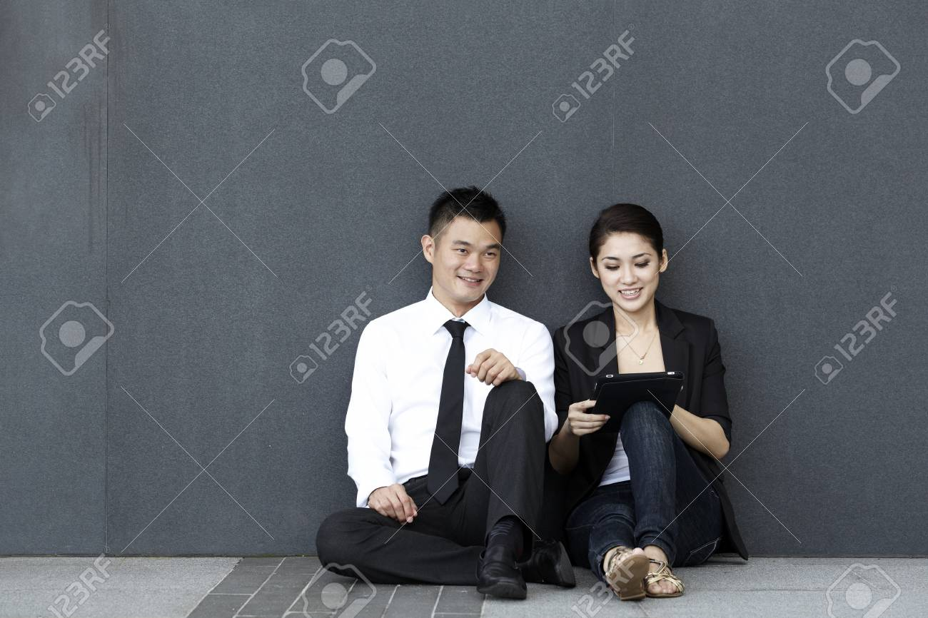 Two business people using a touch pad Stock Photo - 10320623