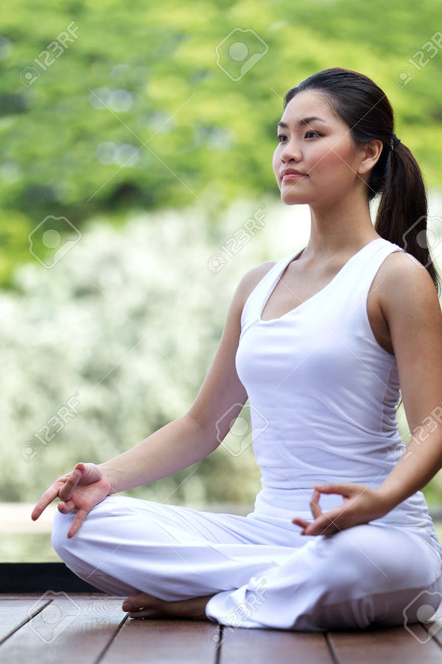 Woman in white Performing yoga in natural setting Stock Photo - 10322928