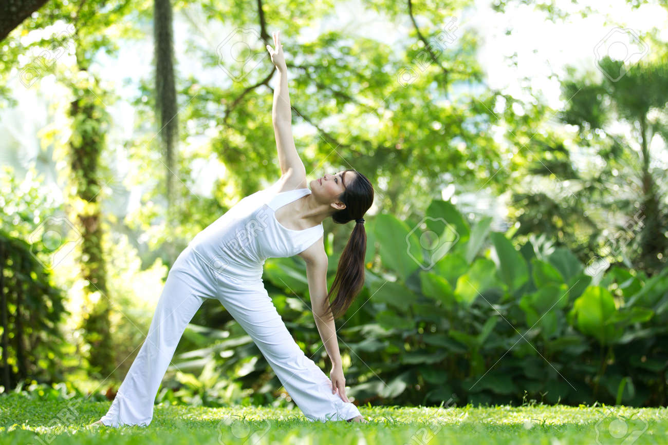 Woman in white Performing yoga in natural setting Stock Photo - 10322471
