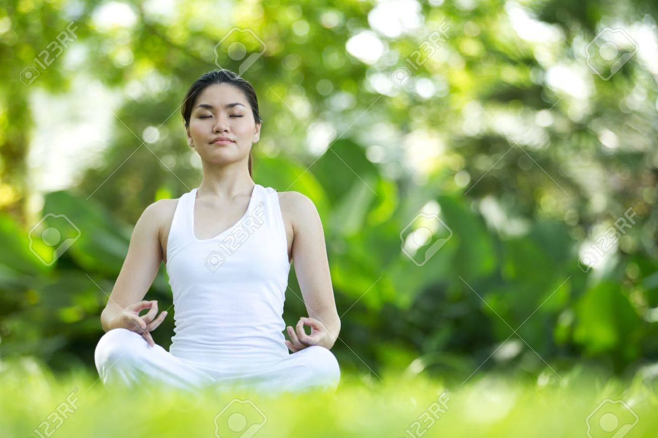 Woman in white Performing yoga in natural setting Stock Photo - 10322475