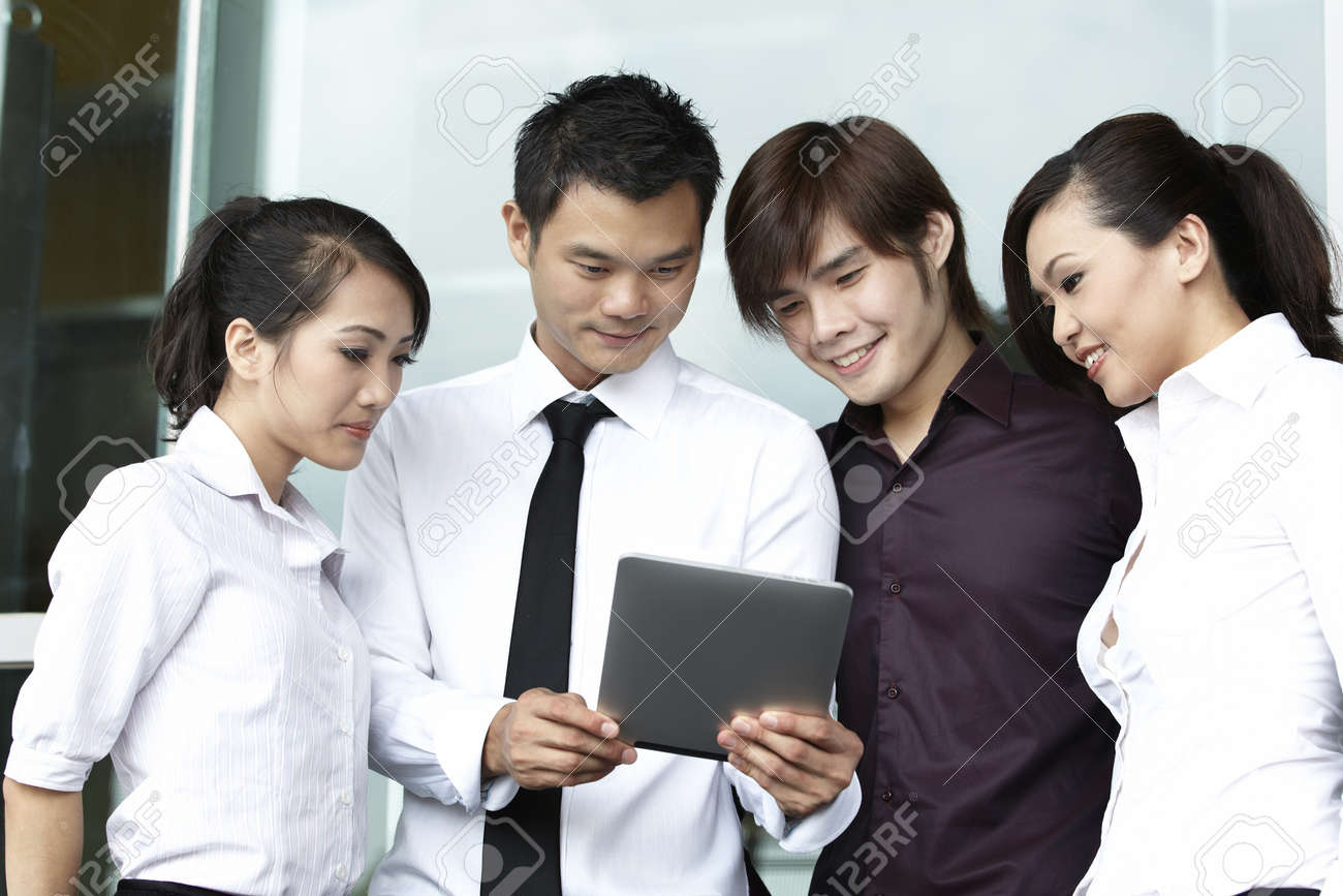 Asian business people using a Digital Tablet computer Stock Photo - 10670248