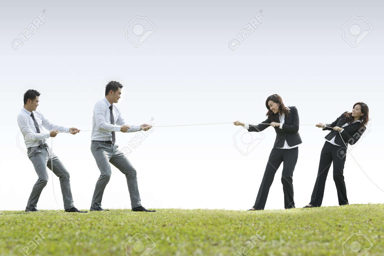 Conceptual image, Asian Business man and woman playing tug of war Stock Photo - 10906776