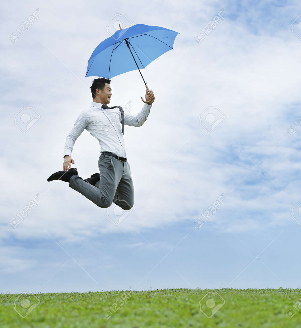 Conceptual Stock image of an Asian business man jumping for joy Stock Photo - 10963440