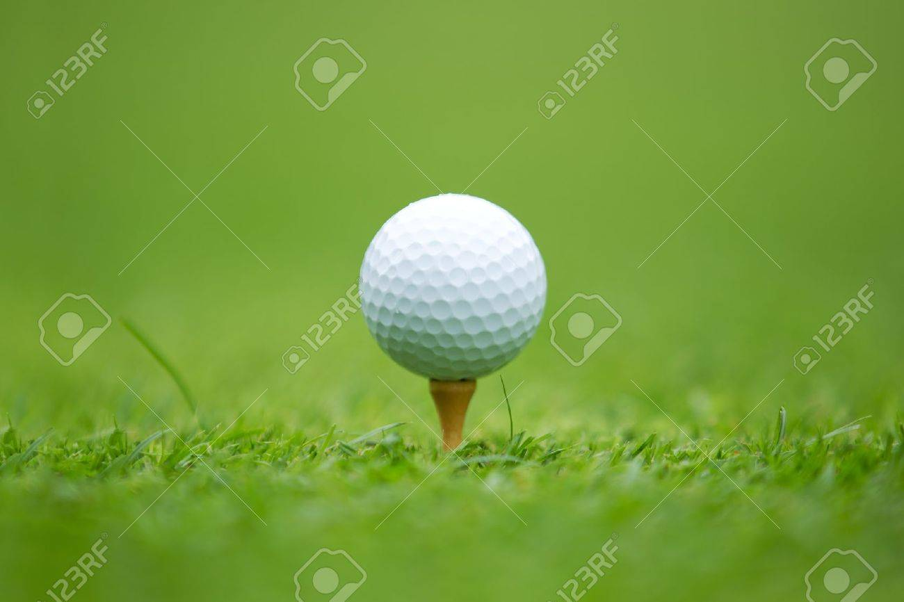 A close-up of a Golf ball sitting on a tee Stock Photo - 11589224