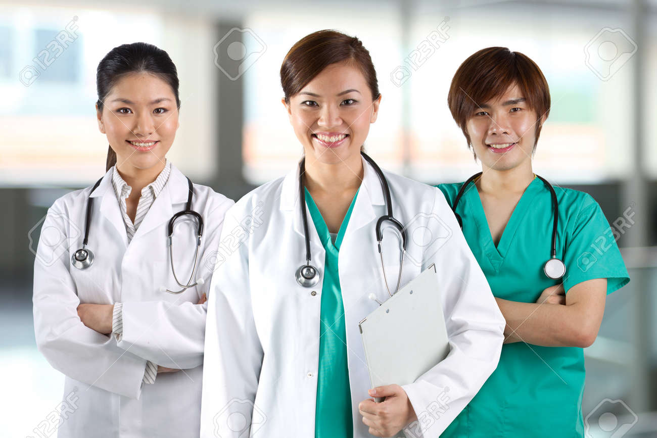 Three Asian Doctor Wearing A White Coats With Stethoscope's. Stock ...