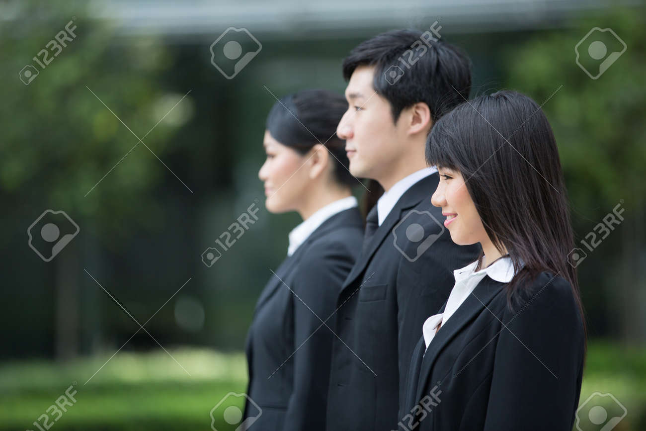 Group of happy Asian business people standing in row. Stock Photo - 13194351