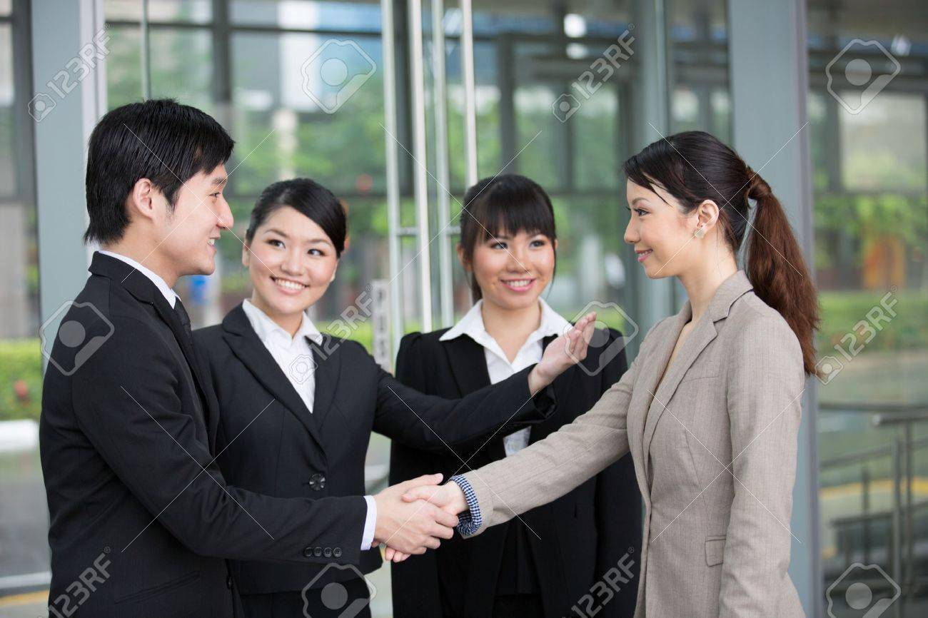 Asian business man and woman shaking hands. Stock Photo - 13194405
