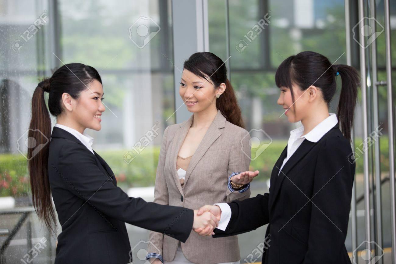 Asian business women shaking hands. Stock Photo - 13194206