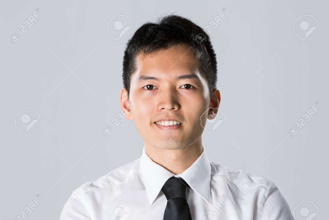 Portrait of a Happy Asian business man. Stock Photo - 13867135