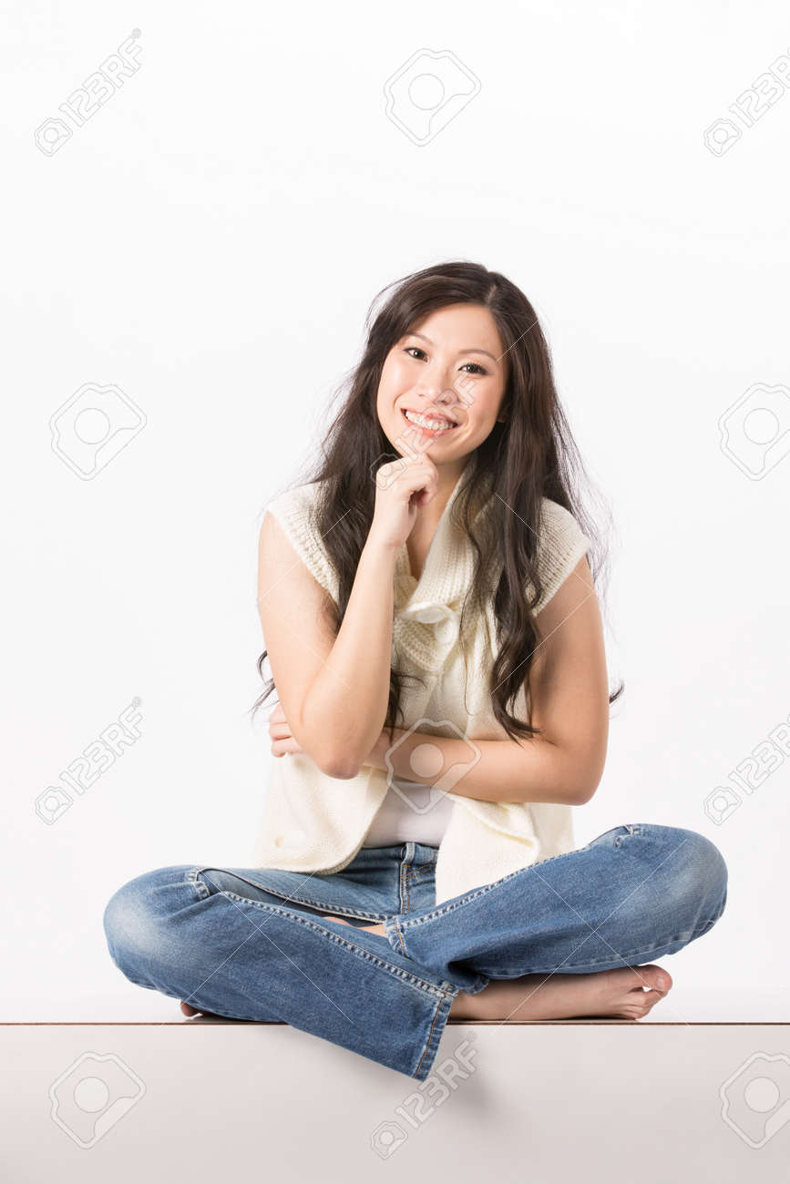 Happy Asian woman in casual clothes. Isolated on white background. Stock Photo - 13990695