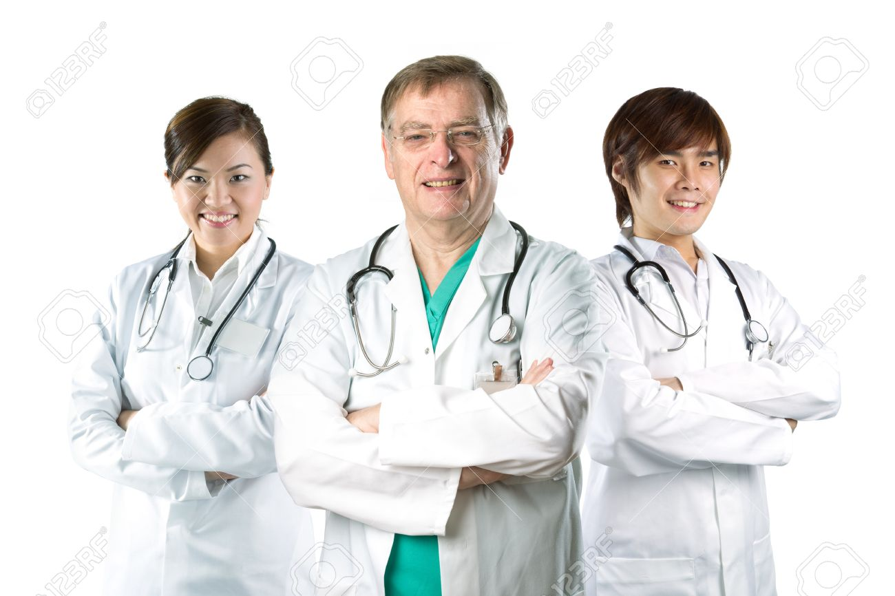 Multiracial Team Of Doctors Wearing A White Coats With