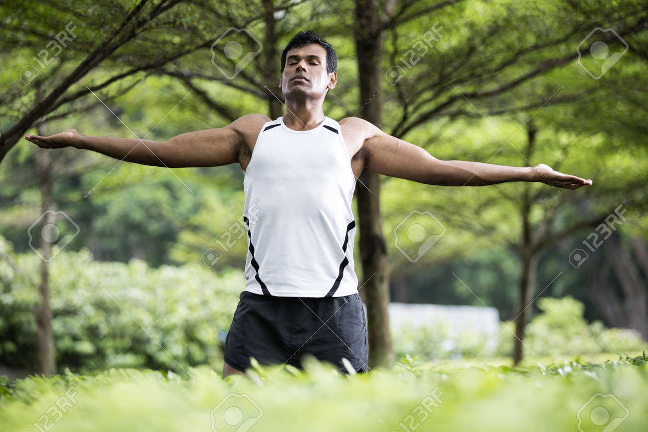 Portrait Of Indian Man Doing Yoga Exercise In Park With Arms Stock Photo Picture And Royalty Free Image Image 19381715