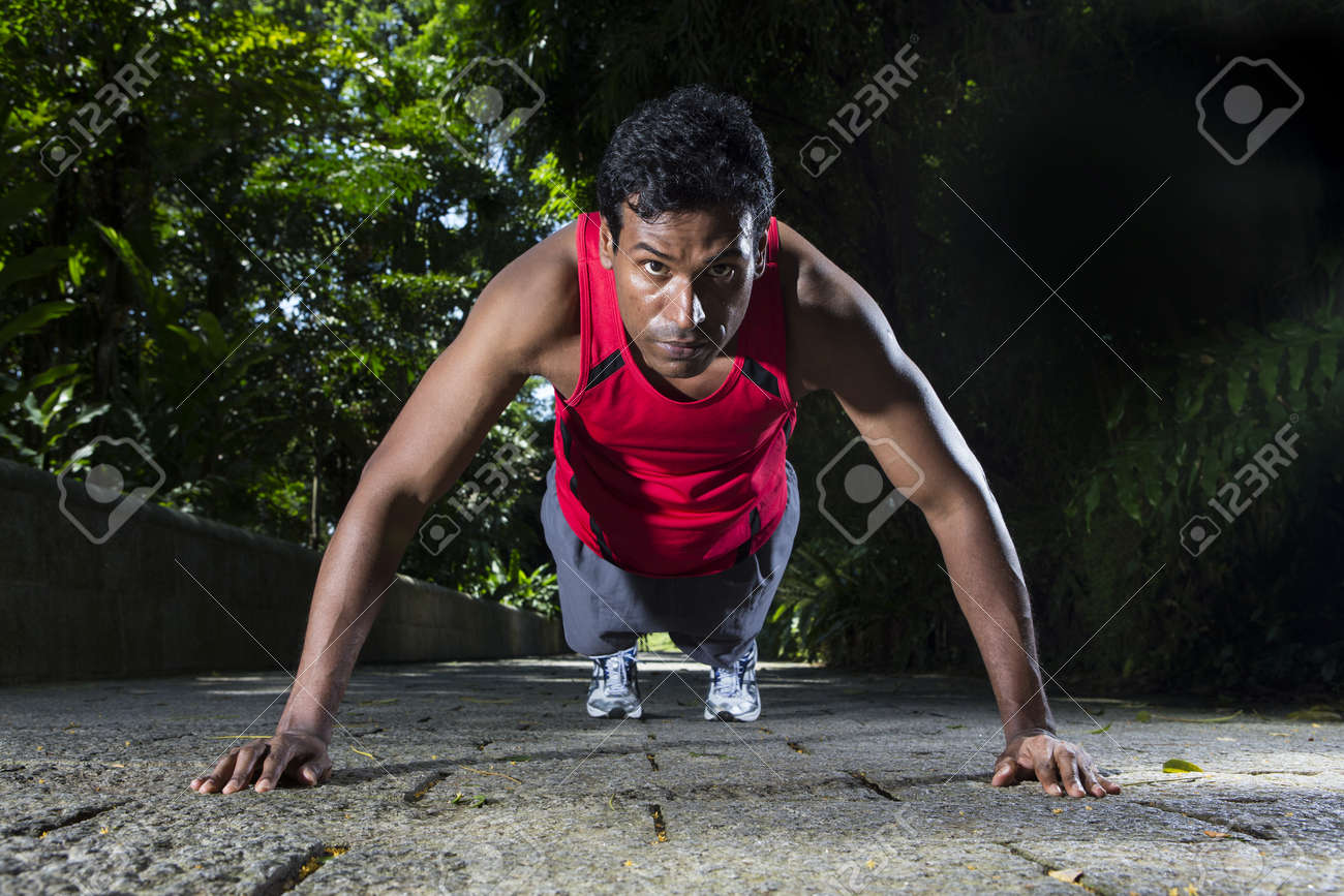 Indian man performing push up in the city park. Male fitness concept. Stock Photo - 19590171