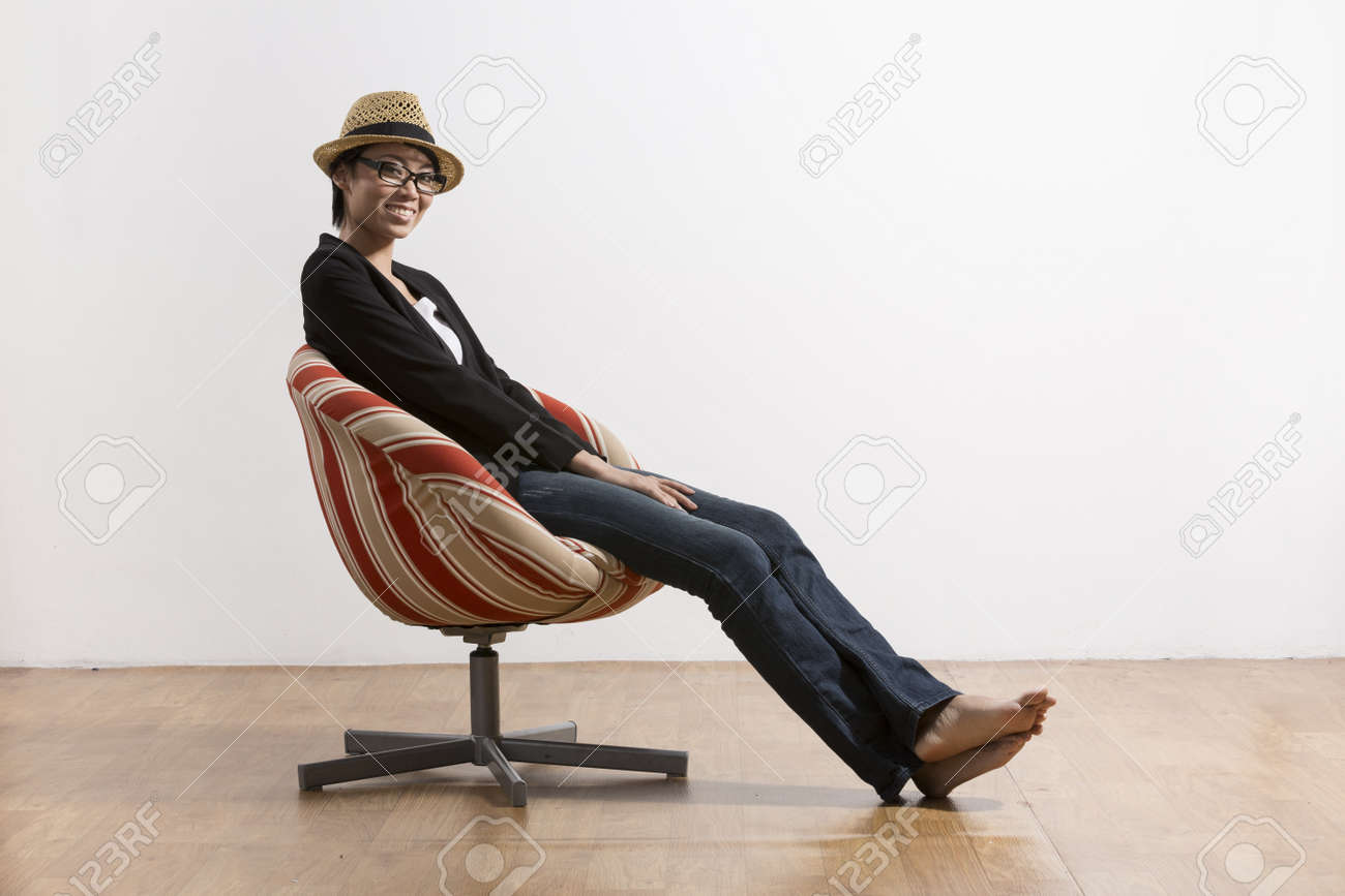 Man sitting in chair side - Side View Portrait Of A Young Chinese Girl Sitting On Chair Stock Photo 19686934