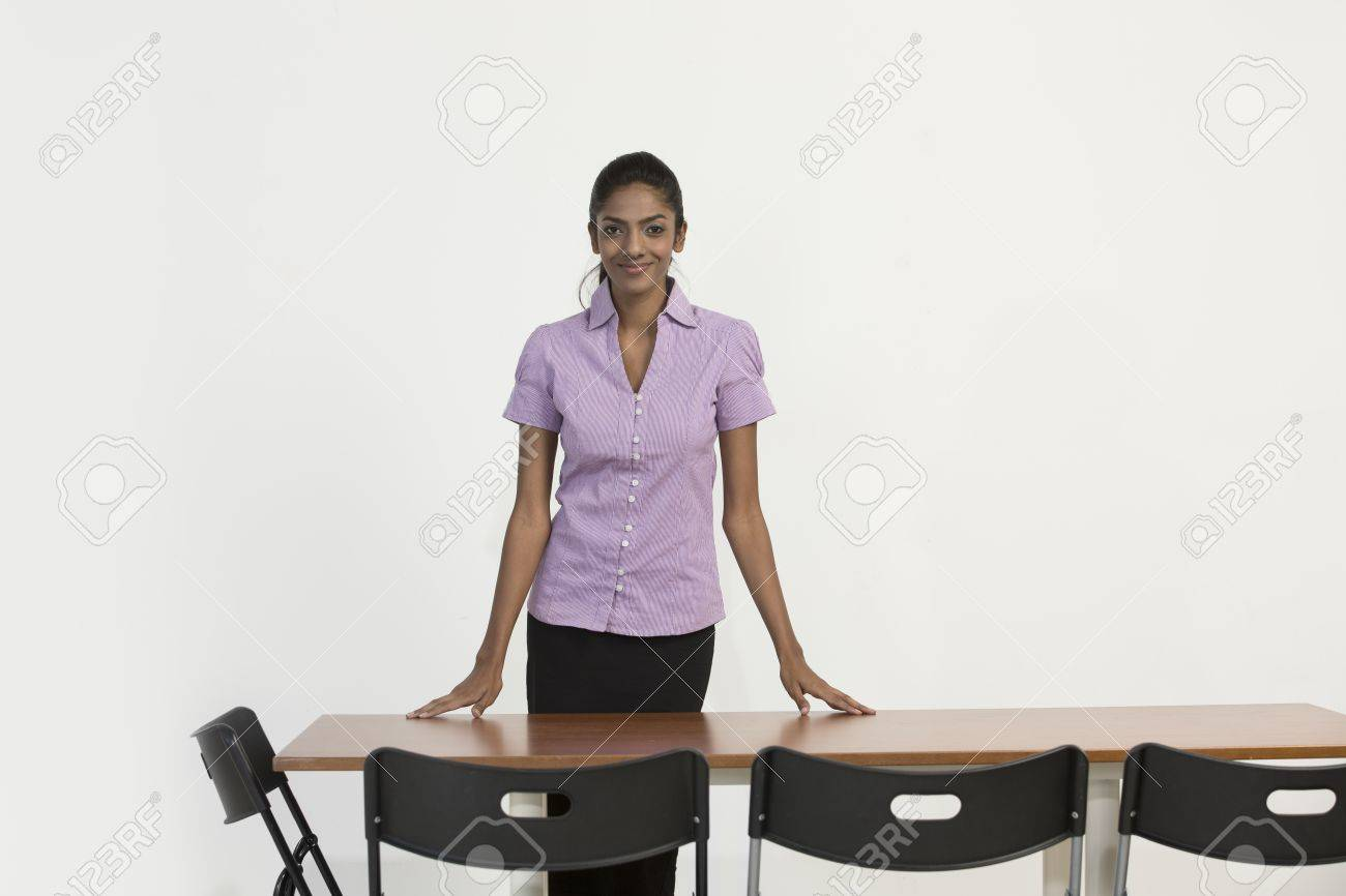 Portrait of an Indian female office executive standing in an office. Stock Photo - 22240232