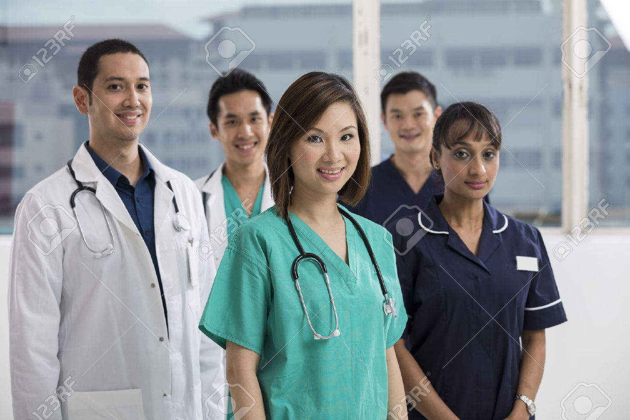 Group of doctors and nurses standing in a hospital. Multi-ethnic team of caucasian, Chinese and indian medical staff. Stock Photo - 22365679