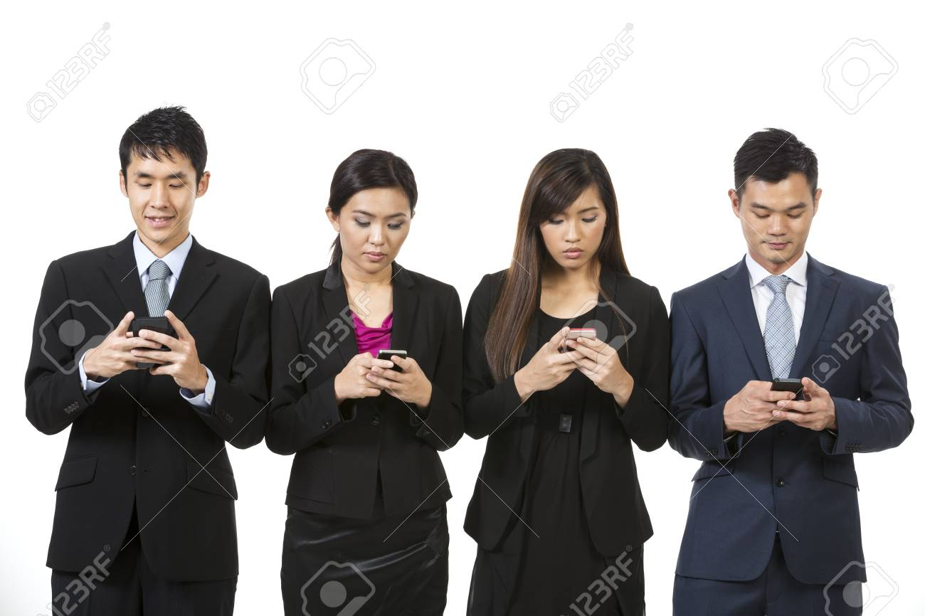 Chinese business team using modern smartphones. Isolated on white background. Stock Photo - 24119960