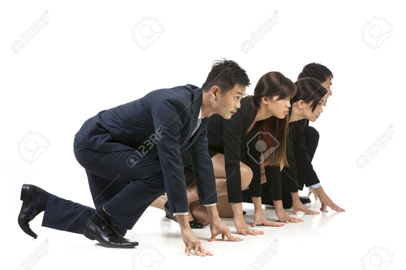 Chinese business team ready to start a race. Conceptual image about competition. Isolated on white background. Stock Photo - 24120715