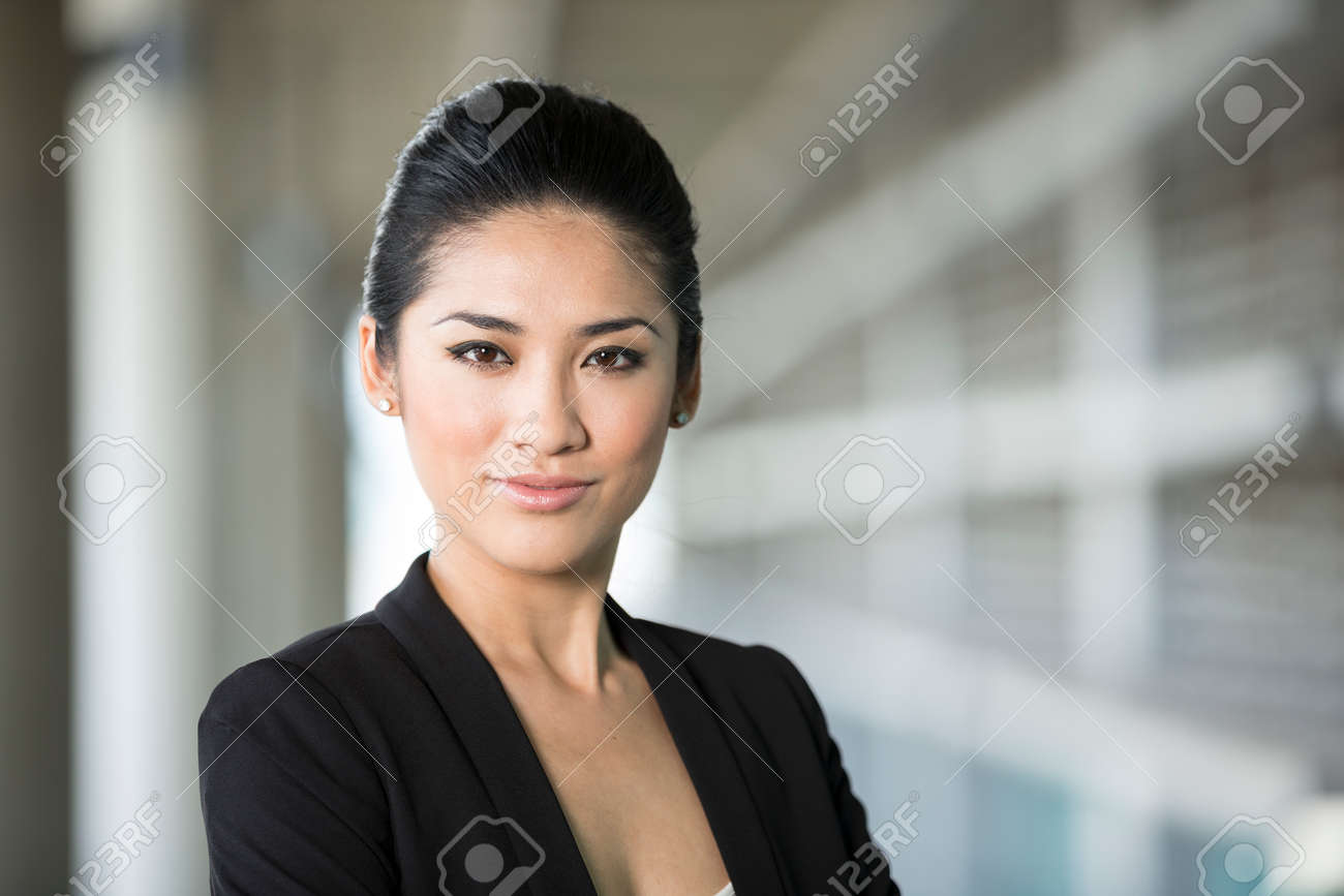 Portrait of a confident Chinese business woman. Happy Asian businesswoman. Stock Photo - 28190091