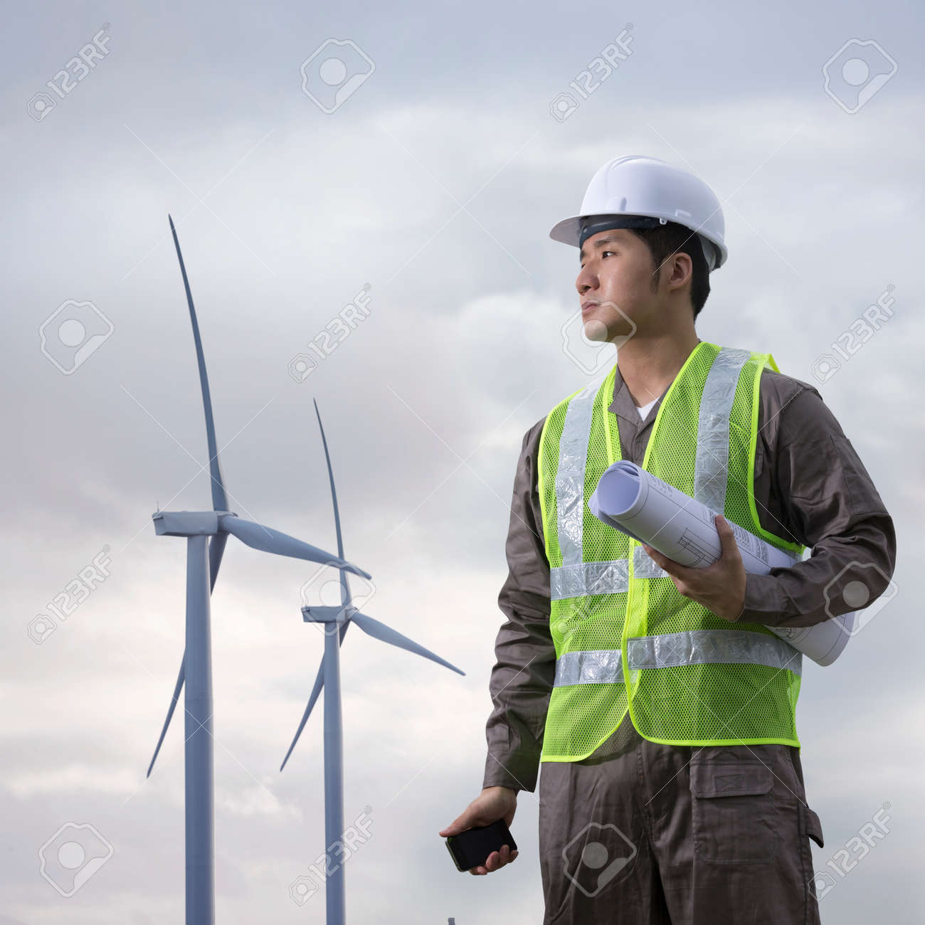 Portrait of a male Chinese industrial engineer at work checking winturbines Stock Photo - 28193032